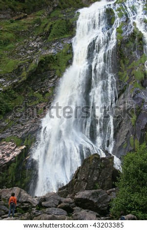 Powerscourt Waterfall attracted attention by the beautiful cascade flowing down - stock photo