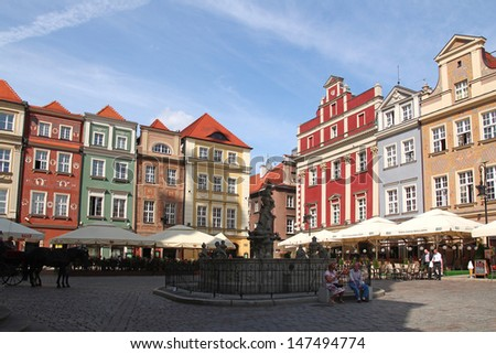 POZNAN - JULY 19: Colorful architecture and fountain at Old Market Square in Poznan; on July 19, 2013 in Poznan, Poland. The city is the 4th largest and the 3rd most visited city in Poland.