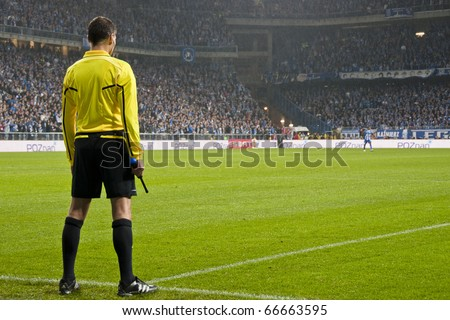POZNAN, POLAND - JULY 4, European League group match Lech Poznan - FC Manchester City 3-1, fourth and fifth referees in European League, on July 4, 2010 in Poznan, Poland