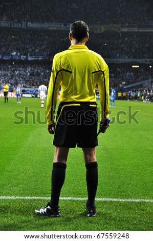 POZNAN, POLAND - JULY 4: Football referee behind the end line of playing field on July 4, 2010 in Poznan, Poland. European League group match Lech Poznan - Manchester City 3-1