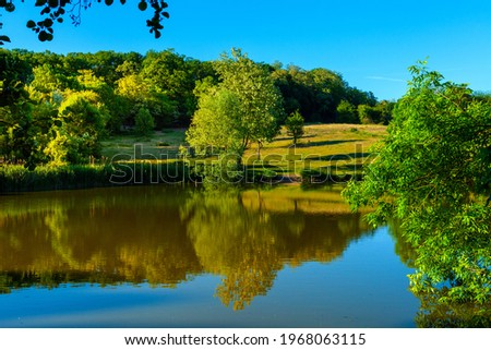 Poznan, Poland - June 5, 2015: Panoramic view of the lake and forest landscape of New ZOO Zoological Garden in Malta district