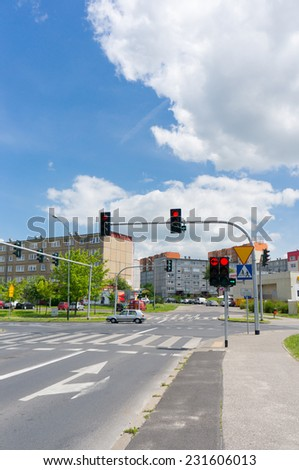 POZNAN, POLAND - JUNE 01, 2014: Traffic lights by an intersection close to apartment buildings
