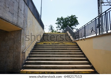 POZNAN, POLAND - MAY 26, 2017: Stairs leading front the underground to the streets on a sunny day  #648217513
