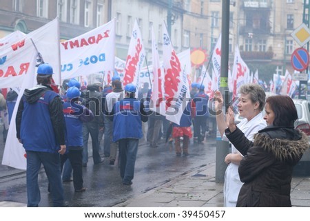 POZNAN, POLAND - OCTOBER 23: Polish 'Solidarnosc' workers from H.Cegielski factory and shipyards on manifestation over pay, unemployment and recession on October 23, 2009 in Poznan, Poland.