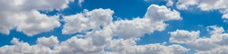 Ppanoramic blue sky panorama with bright louds. Sky panorama with cotton puffy clouds