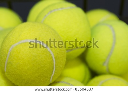 Practice, tennis balls are piled high, waiting for lessons or game preparation.