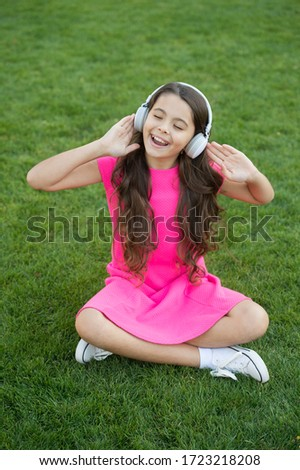Practicing her singing. Happy singer sing song outdoors. Little girl enjoy singing to music. Vocal exercises. Enjoying solo singing. Summer fun. Discover your singing voice.