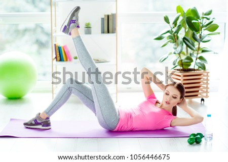 Practicing mat floor bodycare athlete physical muscles building concept. Enduring purposeful charming attractive strong woman doing exercised at home to be fit preparing shape for summer #1056446675