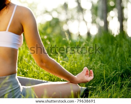Practicing of yoga outdoors.