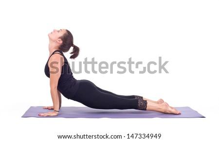 Practicing Yoga exercises. Young  woman doing  Yoga exercises in studio on white background.  Pose name: Upward Facing Dog - Urdhva Mukha Svanasana