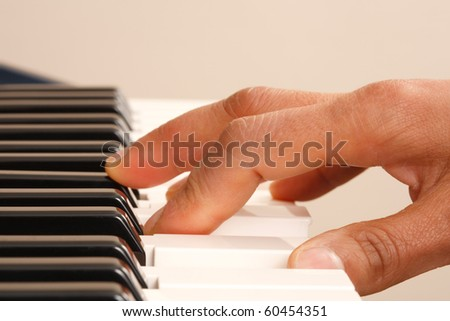 Practising piano - stock photo