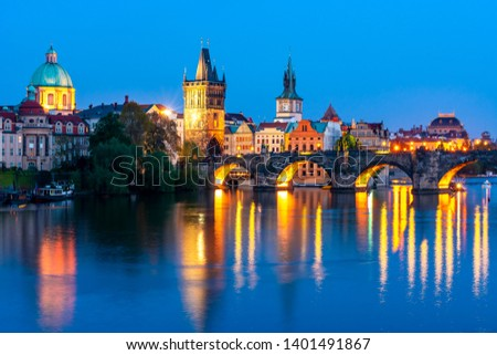 Prague architecture and Charles bridge over Vltava river at night, Czech Republic
