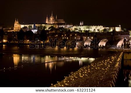 Prague at night. Castle and Charles Bridge, seen on the river Vltava