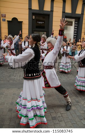 PRAGUE - AUGUST 26: Unknown people dance in traditional Russian costumes at Folklore Festival Prague Fair, 25-30.8.2009, close to the Old Town Square on August 26, 2009 in Prague, Czech Republic