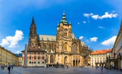 Prague, bell gothic towers and St. Vitus Cathedral. St. Vitus is a Roman Catholic cathedral in Prague, Czech Republic. Panoramic view from the courtyard to the south facade. Prague, Czechia.