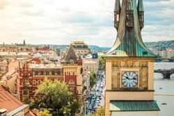 Prague, Bohemia, Czech Republic. Old town cityscape of Praha with dome, houses, clock tower, national theater.