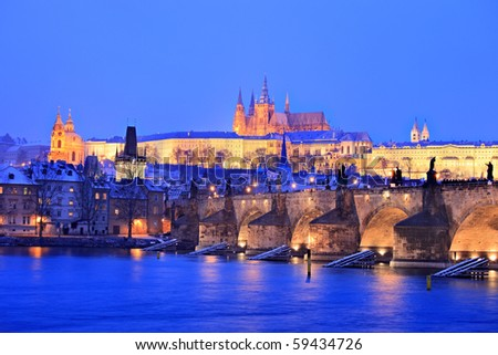 Prague castle and Charles bridge in winter, Prague, Czech Republic - stock photo