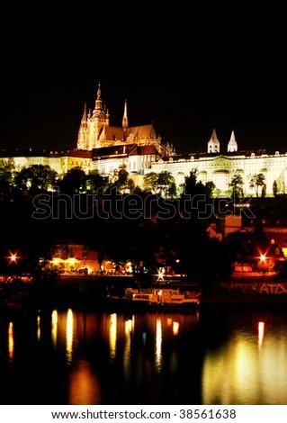 Prague Castle at night,  reflection in the river. Prague, Czech Republic