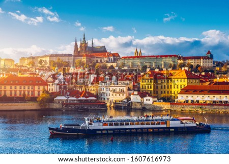 Prague Castle, Charles Bridge and boats on the Vltava river. View of Hradcany Prague Castle, Charles Bridge and a boats on the Vltava river in the capital of the Czechia. Boat cruise on Vltava river. Stock photo ©
