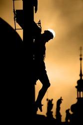 Prague cross on the charles bridge by sunrise - silhouette