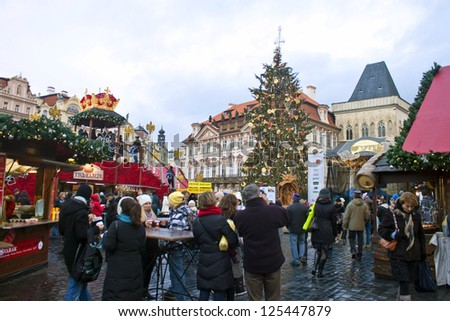 PRAGUE, CZECH REP. - NOVEMBER 4: Visitors of Christmas market on Old Town Square on November 4, 2011 in Prague, Czech Republic. This is the largest and most popular Christmas market in Prague.