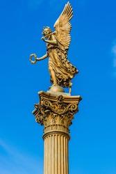 Prague, Czech Repoublic: Statue of an angel in front of the Rudolfinum concert hall.