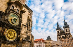 Prague, Czech Republic. Astronomical clock, main square and Church of Our Lady before Tyn.