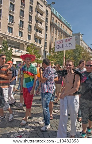 "PRAGUE, CZECH REPUBLIC - AUGUST 18: Participants carrying a sign ""Pussy Riot Continues"" and spectators at the second Prague Pride Parade, on August 18, 2012 in Prague, Czech Republic"
