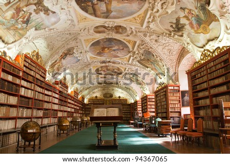PRAGUE, CZECH REPUBLIC - AUGUST 14: The Theological Hall in Strahov monastery with stucco decoration and paintings from 1720s on August 14, 2009 in Prague. Library with ancient books, globes