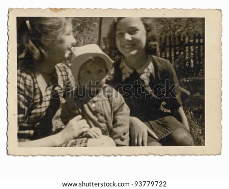 PRAGUE , CZECH REPUBLIC , CIRCA 1940 - An unidentified three kids, girls