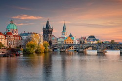 Prague, Czech Republic. Cityscape image of famous Charles Bridge in Prague during beautiful autumn sunset.