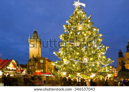 PRAGUE, CZECH REPUBLIC- DEC 02, 2015: Prague Christmas market on Old Town Square with gothic town hall tower. Centre of Prague is UNESCO protected.