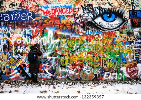 PRAGUE CZECH REPUBLIC DECEMBER 11 The Lennon Wall since the 1980s filled with John Lennon-inspired graffiti and pieces of lyrics from Beatles songs on December 11 2012 Prague Czech Republic