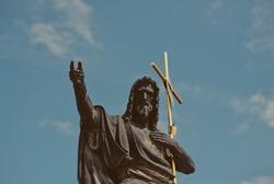 PRAGUE, CZECH REPUBLIC - July 28, 2013:Statue of St. John the Baptist on Charles Bridge