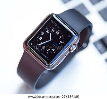 PRAGUE, CZECH REPUBLIC - June 22, 2015: New wearable Apple Watch smartwatch displaying the Home screen. Apple Watch has fitness tracking and health-oriented capabilities with iOS products.