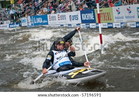 PRAGUE, CZECH REPUBLIC - JUNE 19: Paddler brothers Pavol and Peter Hochschorner navigate through one of the gates during World Cup 2010 race in Prague Troja June 19, 2010 in Prague, Czech Republic.