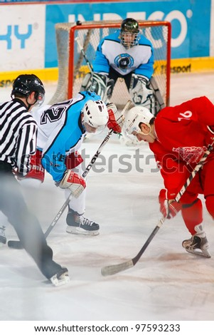 PRAGUE, CZECH REPUBLIC - MAY 7: Face off during final match of university league between of Charles University (red) and VSE (white) on May 7, 2012 in Prague, Czech Republic.
