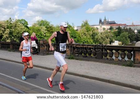 PRAGUE, CZECH REPUBLIC - MAY 12: Group of runners runs the Volkswagen Prague Marathon, May 12, 2013 in Prague,