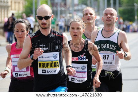 PRAGUE, CZECH REPUBLIC - MAY 12: Group of runners runs the Volkswagen Prague Marathon, May 12, 2013 in Prague,