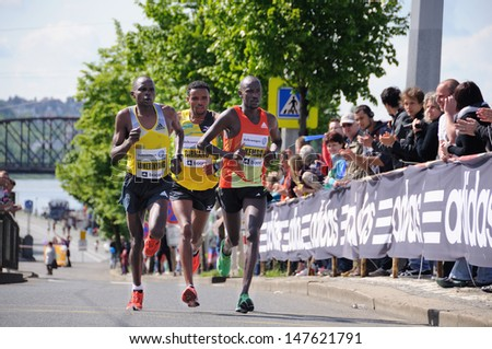 PRAGUE, CZECH REPUBLIC - MAY 12: Leading group of runners runs the Volkswagen Prague Marathon, May 12, 2013 in Prague,