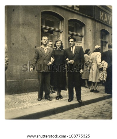 PRAGUE, CZECHOSLOVAK REPUBLIC, CIRCA 1955 - friends before old Prague pub - circa 1955