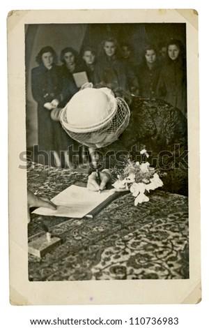 PRAGUE, CZECHOSLOVAKIA, CIRCA 1950 - woman signed as a witness at the wedding ceremony - circa 1950