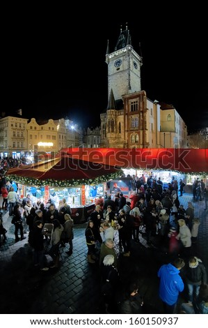 PRAGUE - DECEMBER 2: Christmas market on the Old Town Square at evening on December 2, 2011 in Prague, Czech Republic. The Old Town Square Christmas market is the prettiest and busiest one in Prague.