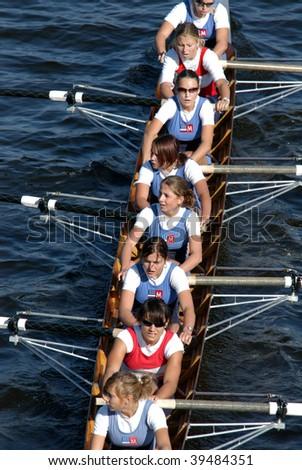 PRAGUE - JUNE 6: Junior female rowing team 'Sprata' rowing ahead during a boat-race on June 6, 2009 in Prague, Czech Republic.
