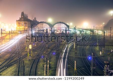 Prague main railway station/Praha hlavni nadrazi in the foggy autumn night with city lights. Czech railway