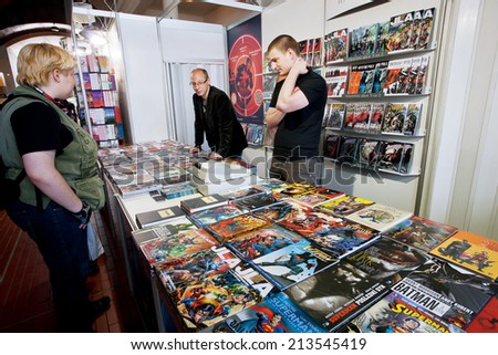 PRAGUE - MAY 15: People talk about comic books at graphic novels stand of store on May 15, 2014. Association of Czech Booksellers celebrate the anniversary of the writer Bohumil Hrabal in 2014.