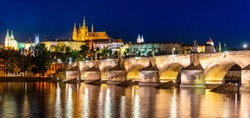 Prague night panorama. Prague Castle and Charles Bridge above Vltava River, Praha, Czech Republic.