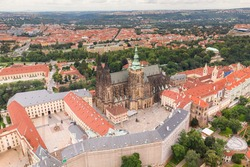Prague Old Town with St. Vitus Cathedral and Prague castle complex with buildings revealing architecture from Roman style to Gothic 20th century. Prague, capital city of the Czech Republic. Drone