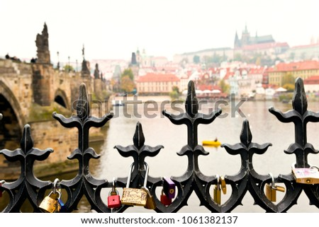 Prague riverbank with locks of love on the fence, #1061382137