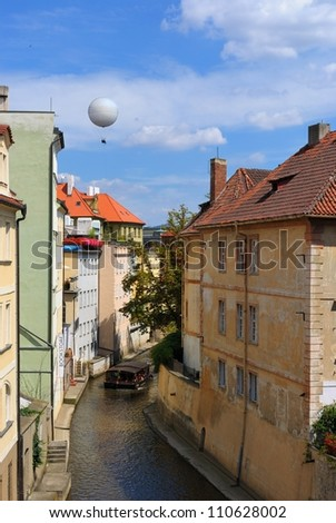 Prague skyline over a small tributary canal of the Vltava River in Czech, Republic.